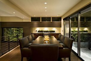 Contemporary Dining Room with Hardwood floors, Standard height, Built-in bookshelf, Loft, specialty window, French doors