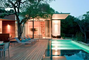 Modern Swimming Pool with sliding glass door, Deck Railing, Pathway, Infinity pool, picture window, Transom window