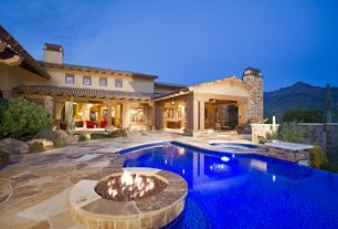 Mediterranean Swimming Pool with French doors, exterior stone floors, Infinity pool, Fire pit, Pathway