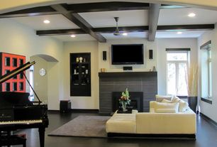 Modern Living Room with Box ceiling, Exposed beam, Built-in bookshelf, Ceiling fan, stone fireplace, Concrete floors