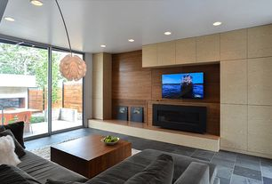 Contemporary Living Room with insert fireplace, sliding glass door, Concrete tile , can lights, Fireplace, Standard height