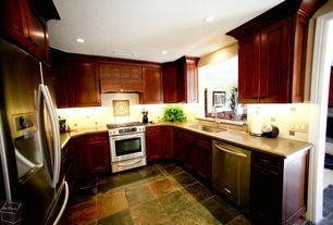 Traditional Kitchen with Flat panel cabinets, can lights, gas range, U-shaped, Corian counters, Built In Refrigerator