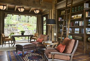 Rustic Living Room with Traditional amalfi oriental area rug, French doors, Motif leg table, Floor to ceiling curtains