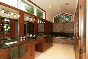 Contemporary Master Bathroom with Complex Granite, drop in bathtub, stone tile floors, Bathtub, European Cabinets, Flush