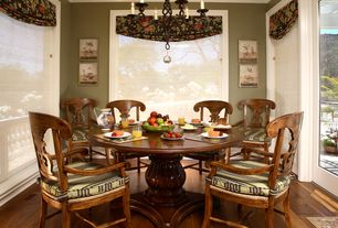 Traditional Dining Room with Chandelier, picture window, Hardwood floors, Crown molding, Standard height
