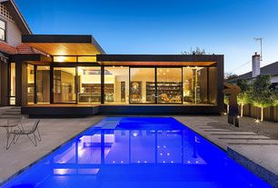 Modern Exterior of Home with Lap pool, Glass door, Gravel landscape