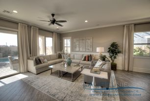 Traditional Living Room with sliding glass door, Accent pillows, Wainscotting, can lights, Chair rail, Casement, Coffee table