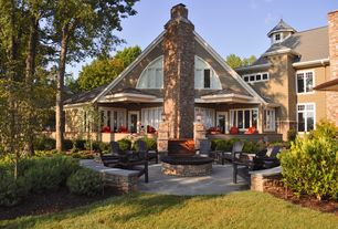Traditional Patio with Pathway, exterior stone floors, Arched window, Fire pit, French doors, Deck Railing, Casement