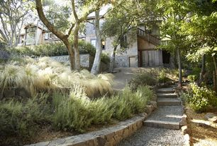 Craftsman Landscape/Yard with Mexican Feather Grass, Pathway, Raised beds, exterior stone floors