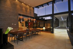 Contemporary Dining Room with Pendant light, High ceiling, sandstone tile floors