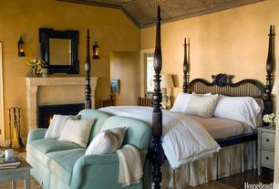 Mediterranean Guest Bedroom with Crown molding, Wall sconce, Hardwood floors, stone fireplace, Standard height, Fireplace