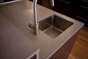Modern Kitchen with One-wall, Complex granite counters, Hardwood floors, Undermount sink, Kitchen island, European Cabinets