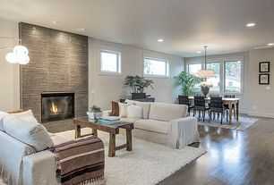 Contemporary Great Room with Standard height, can lights, Fireplace, specialty window, Pendant light, other fireplace