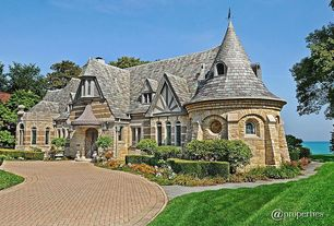 Exterior of Home with Pathway, Red brick driveway, Natural stone facade - exterior house, Arched window