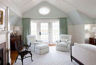 Traditional Master Bedroom with Area rug, Ivory trellis rug, Wood panel wall, French doors, Hardwood floors