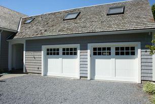 Country Garage with quartz floors, specialty door