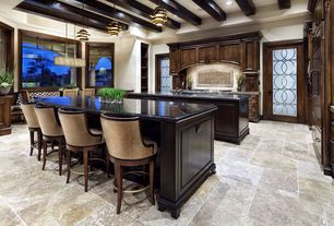 Traditional Kitchen with stone tile floors, Custom hood, Standard height, Black Forest, electric cooktop, Quartz counters