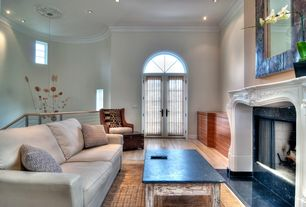 Modern Living Room with stone fireplace, French doors, Crown molding, High ceiling, Hardwood floors, Arched window
