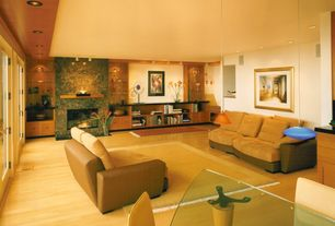 Contemporary Living Room with Built-in bookshelf, Laminate floors, French doors, Standard height, can lights
