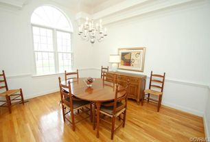 Traditional Dining Room with Arched window, Chair rail, Chandelier, Hardwood floors, Crown molding