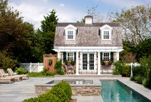 Traditional Swimming Pool with French doors, Fence, exterior stone floors, Lap pool