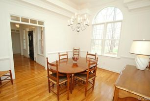 Traditional Dining Room with Arched window, Crown molding, Chandelier, Hardwood floors, Chair rail