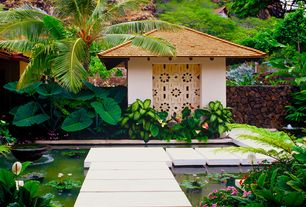 Tropical Landscape/Yard with Fountain, Pond, Fence, Elephant Ears Bulbs, exterior tile floors, Pathway