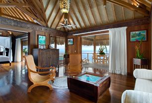 Tropical Living Room with Laminate floors, Exposed beam, French doors, High ceiling, flush light, Ceiling fan