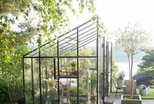 Eclectic Landscape/Yard with Pathway, Sunroom, Raised beds, Crushed Rock & Driveway Gravel, French doors, Skylight