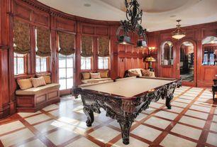 Traditional Game Room with Window seat, Hardwood floors, Standard height, Crown molding, Built-in bookshelf, Pendant light