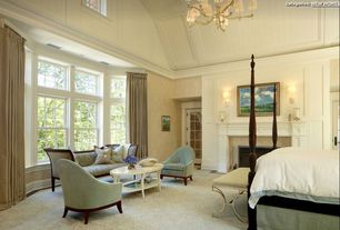 Traditional Master Bedroom with Bay window, French doors, Crown molding, Cement fireplace, Carpet, Wall sconce, Chandelier