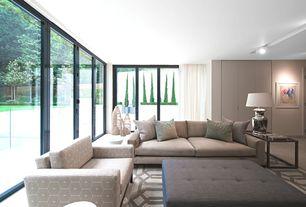 Contemporary Living Room with flush light, French doors, sandstone tile floors