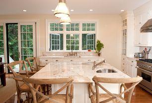 Cottage Kitchen with full backsplash, Wall Hood, sliding glass door, Flat panel cabinets, Glass panel, L-shaped, Casement