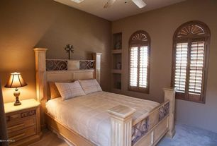 Craftsman Guest Bedroom with Ceiling fan, Built-in bookshelf, Arched window, Carpet