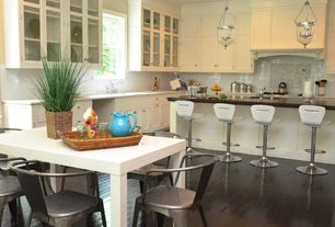 Contemporary Kitchen with Kitchen island, Crown molding, Undermount sink, Glass panel, Subway Tile, European Cabinets