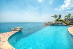 Tropical Swimming Pool with exterior stone floors, Fence, Infinity pool