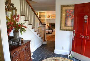 Traditional Entryway with six panel door, soapstone tile floors, Standard height, stone tile floors