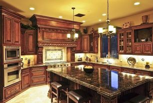 Traditional Kitchen with Stone Tile, Chandelier, Glass panel, limestone tile floors, U-shaped, Breakfast bar, Kitchen island