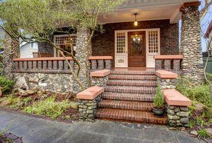 Craftsman Front Door with Glass panel door, Wrap around porch, Deck Railing, exterior brick floors, Pathway, Gate, Casement