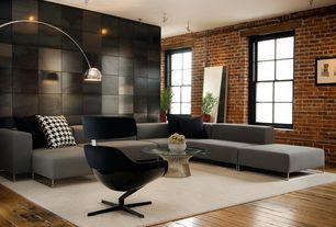 Modern Living Room with interior brick, Spectral Chrome Floor Lamp, High ceiling, Wire side coffee table, Hardwood floors