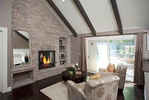 Traditional Living Room with Built-in bookshelf, Exposed beam, interior brick, Hardwood floors
