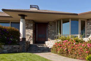 Contemporary Front Door with French doors, Raised beds, exterior stone floors, Bay window, Pathway