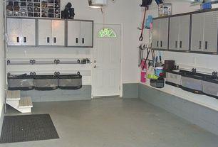 Contemporary Garage with Built-in bookshelf, Paint, Glass panel door, Concrete floors, Standard height