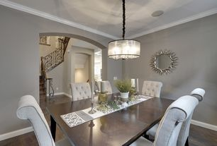 Traditional Dining Room with Chandelier, Crown molding, Coaster nj-08810-2516 starburst mirror, Hardwood floors