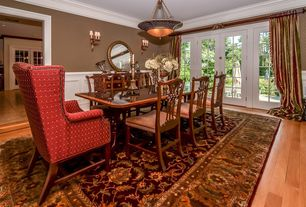 Traditional Dining Room with flush light, Hardwood floors, Crown molding, Wall sconce, French doors, Wainscotting, Chair rail