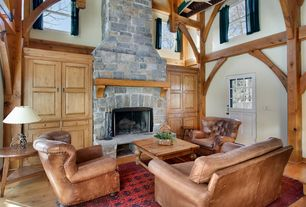 Traditional Living Room with Dutch door, Built-in bookshelf, Glass panel door, stone fireplace, High ceiling, Fireplace