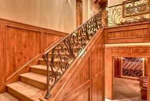 Traditional Staircase with travertine floors, High ceiling, Wall sconce, Wainscotting