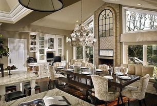 Traditional Dining Room with High ceiling, Window seat, Hardwood floors, 385-5-sc 5 light chandelier, stone fireplace