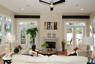 Contemporary Living Room with Hardwood floors, French doors, flush light, Ceiling fan, double-hung window, Fireplace
