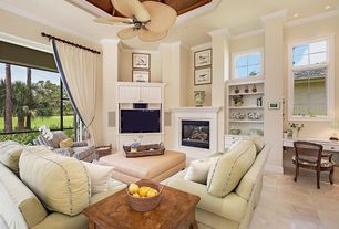 Traditional Living Room with sandstone tile floors, sliding glass door, Crown molding, can lights, stone fireplace, Fireplace